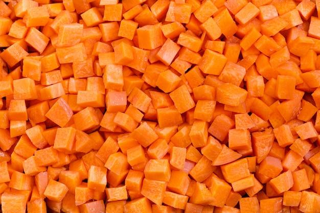 Patrón de cubos de zanahoria picada