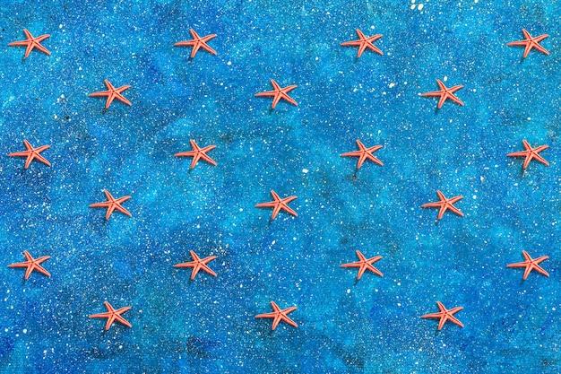 Patrón de estrella de mar en la náutica azul.