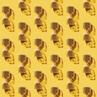 Patrón sin fisuras con reloj de arena con goteo de partículas redondas doradas