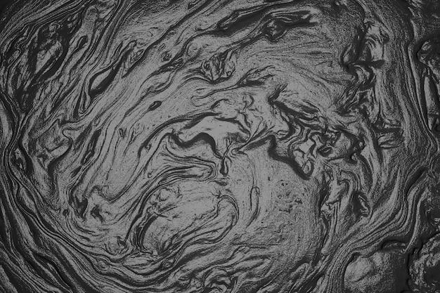 Patrón fluido abstracto de fondo de mármol negro