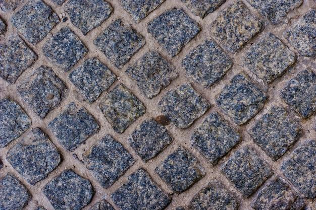 Patrón de geometría de adoquines tradicional pavimento de piedra