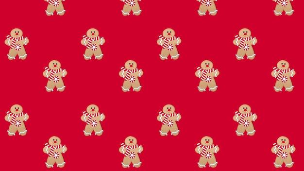 Patrón de hombre de pan de jengibre feliz de navidad sobre un fondo rojo. concepto de año nuevo