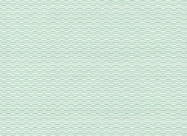 Patrón de línea curva en papel verde.