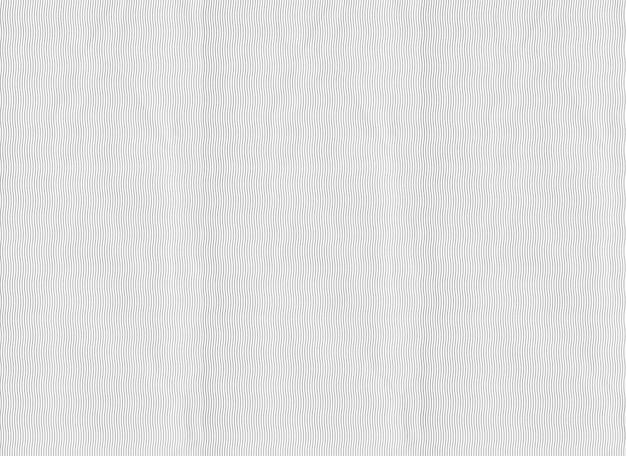 Patrón línea curva sobre papel gris.