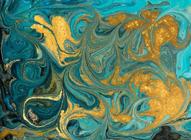 Patrón de marmoleado azul y dorado. textura líquida de mármol dorado.