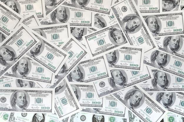 Un patrón de muchos billetes de dólar. imagen de fondo