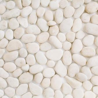 Patrón neutro de piedras beige.