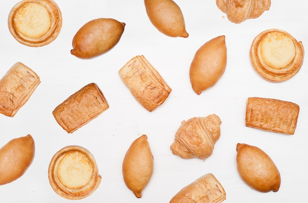 Patrón de panadería y panadería. conjunto de pan fresco. fondo de productos horneados