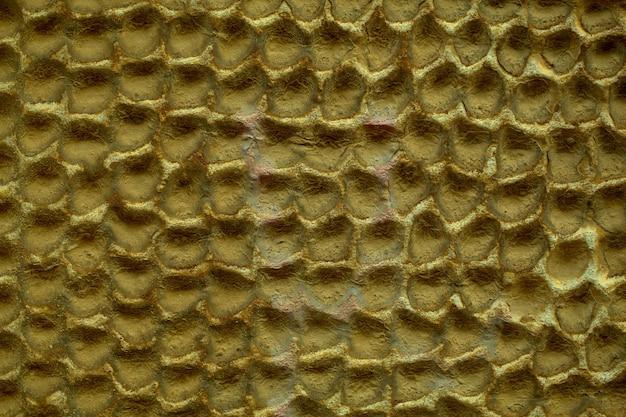 Patrón de panal abstracto de muro de hormigón y textura con pintura lúgubre opaca en una vista de fotograma completo.
