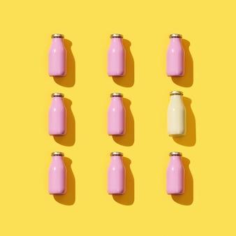 Patrón con pequeñas botellas de vidrio para jugo o yogur. maqueta de plantilla de embalaje