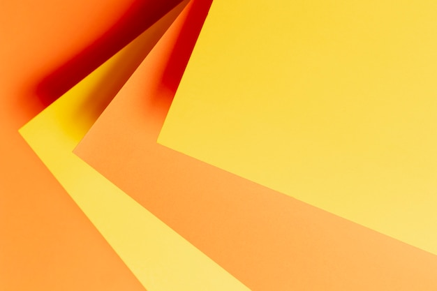 Patrón plano laico con tonos de primer plano naranja