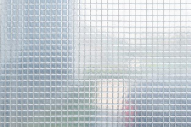 Patrón de plástico cuadrado de hoja transparente, textura, fondo.