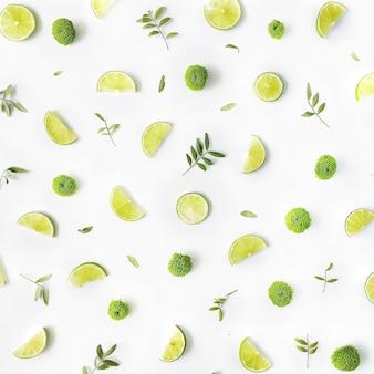 Patrón de ramas de limón y verde sobre blanco