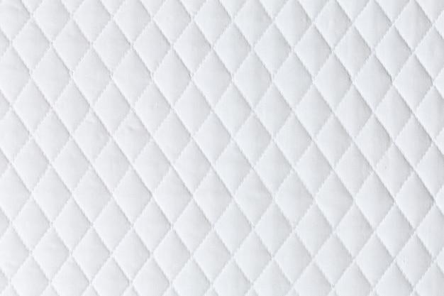 Patrón de ropa de cama de colchón blanco
