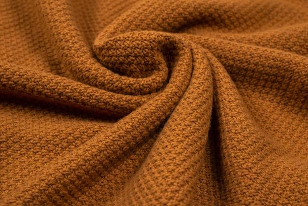 Patrón de tejido de punto marrón. ropa calida.