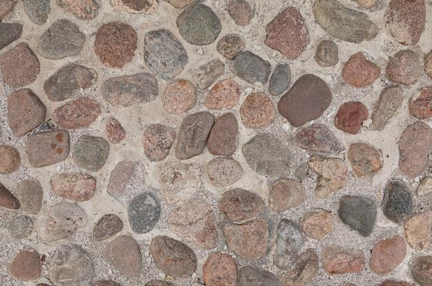Pavimento de adoquines coloridos flatlay, con textura grunge