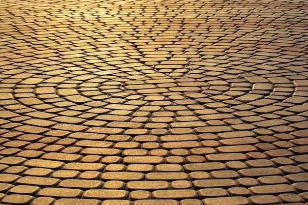El pavimento de cerca a la luz del sol