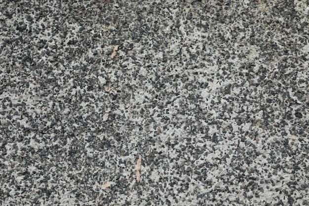Pavimento desigual de beton mezclado con grava