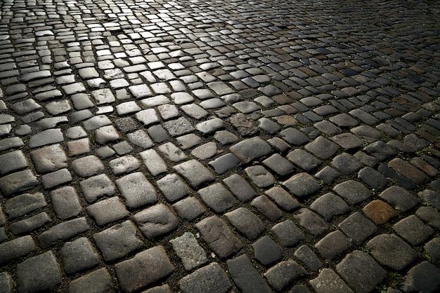 Pavimento de granito adoquinado en calle de alemania.
