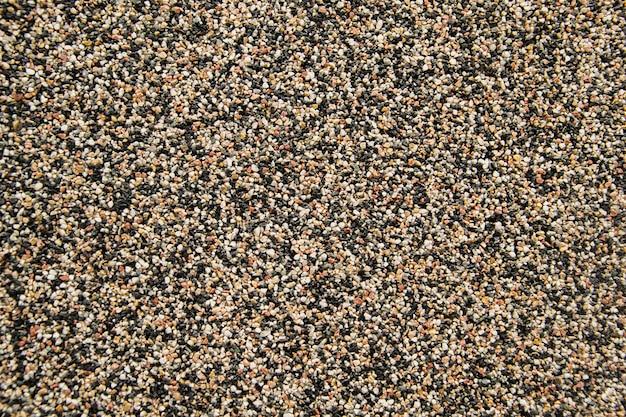 Pequeña piedra de arena de textura de pared de arena o fondo de pared de arena