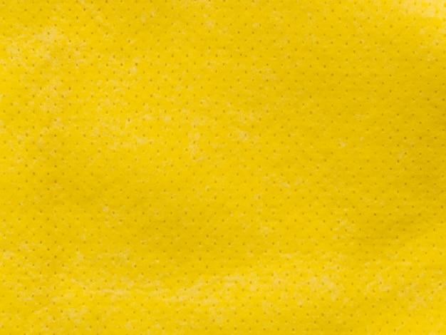 Pequeña tela amarilla punteada textil texturizada