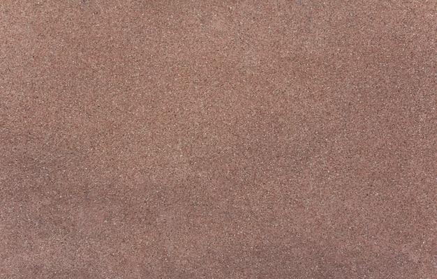 Pequeña textura de granito rosa oscuro. fondo.