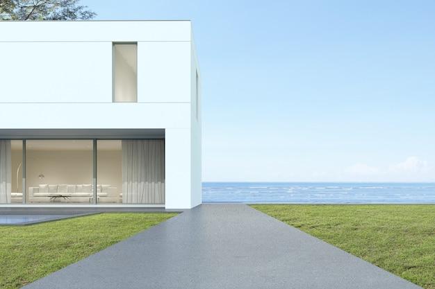 Perspectiva de la casa de lujo moderna con patio de césped con vistas al mar, exterior, arquitectura minimalista. representación 3d.