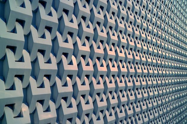Perspectiva decreciente de un edificio decorado con fondo de pared exterior gris metálico