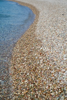 Piedra de guijarros y fondo de mar.