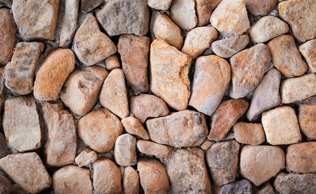 Piedra textura hermosa pared de piedra fondo marrón patrón piedra pared piedra natural backg