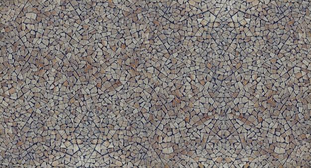 Piedras de grava guijarro mosaico con textura de fondo de la pared