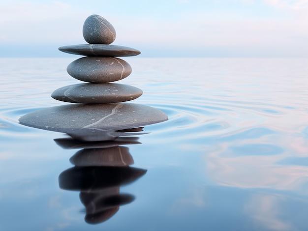 Piedras zen equilibradas en agua