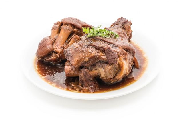 Pierna de cerdo estofado en sopa de salsa