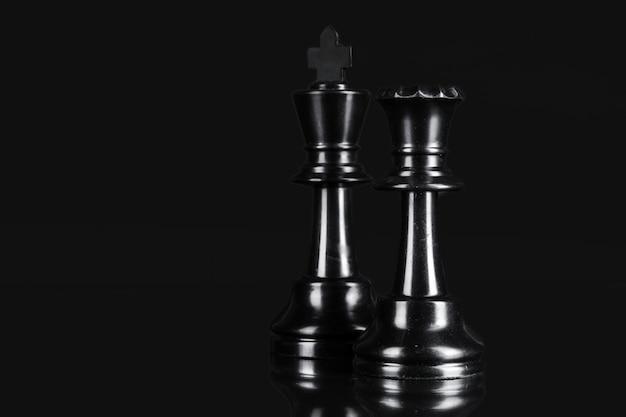 Pieza de ajedrez de cerca en negro. concepto de liderazgo