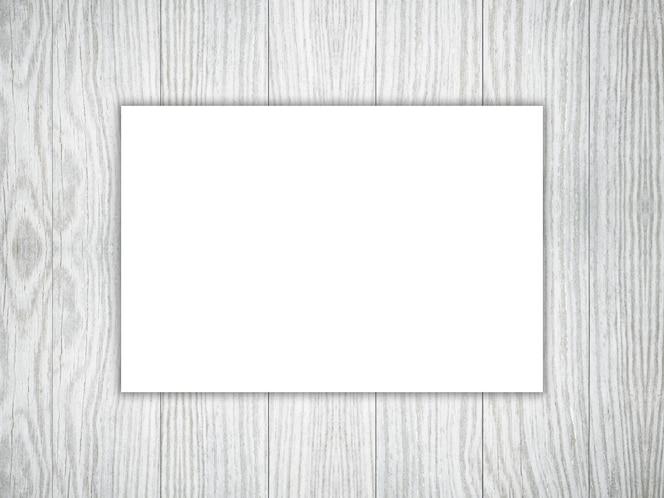 Pieza en blanco 3d de libro blanco sobre una textura de madera