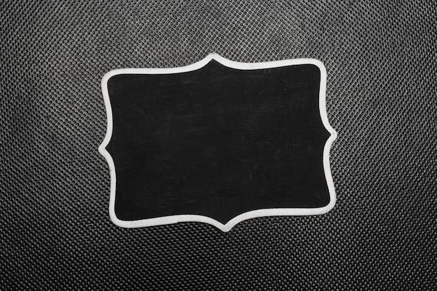 Piezas de papel negro simulacro vista superior sobre fondo negro