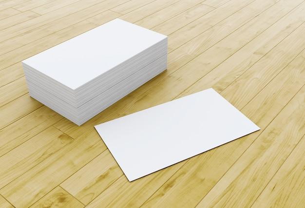 Pila 3d de tarjetas de visita en blanco en la mesa de madera