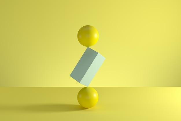 Pila de dos esferas amarillas y caja azul en el centro aislado sobre fondo amarillo.
