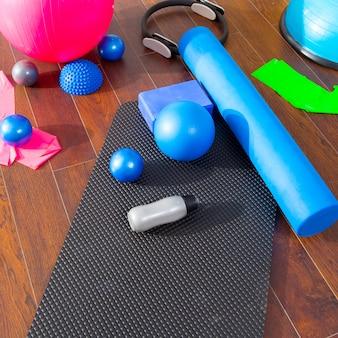 Pilates aeróbico como anillo mágico de bolas de estera