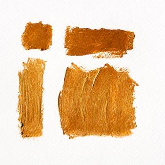 Pincel con partículas de textura dorada