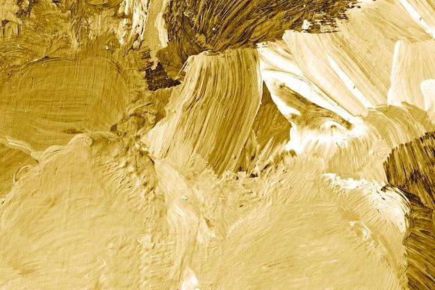 Pincel de pintura de aceite de oro acarició el fondo con textura