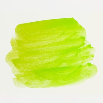 Pincelada de acuarela verde sobre lienzo blanco.