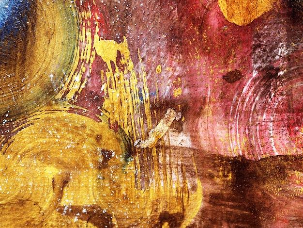 Pincelada oro acrílico pintura fondo abstracto.