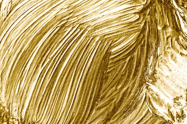 Pincelada de pintura dorada