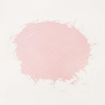 Pinceladas de pintura rosa con espacio para tu propio texto.
