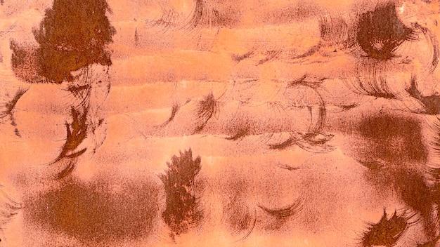 Pinceles abstractos de pintura y fondo de óxido