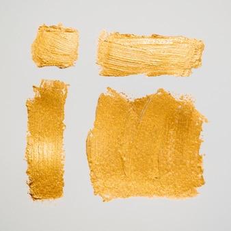 Pinceles gruesos de composición dorada