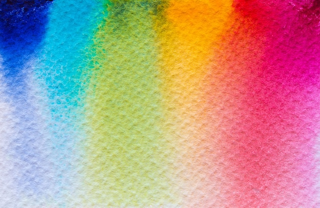 Pintado a mano de rainbow watercolour fondo mojado colorido en el papel. color pastel.