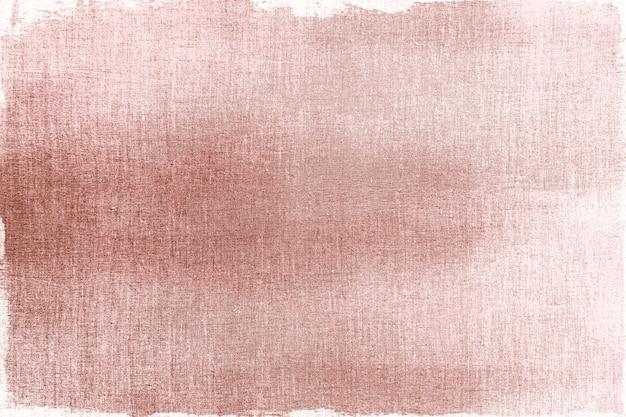 Pintado en oro rosa sobre un fondo de textura de tela