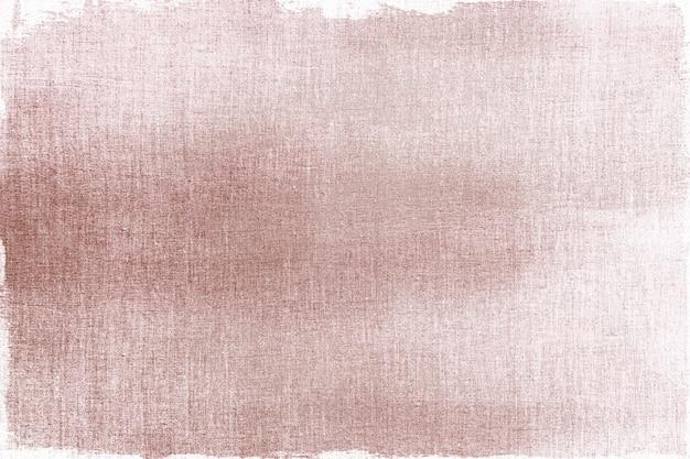 Pintado de oro rosa sobre una tela texturizada